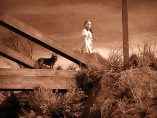 Picture of Dorothy on bridge in Kansas, Click this picture to enter Wendy's Wizard Of Oz